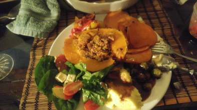 Roasted squash with stuffing, mashed potatoes, sweet potatoe pie, greek salad, and more. Not the most traditional Thanksgiving dinner but one of the most special Thanksgivings I've ever had!